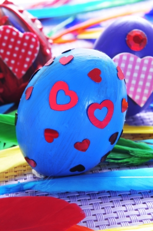 a pile of easter eggs painted in different colors and patterns photo