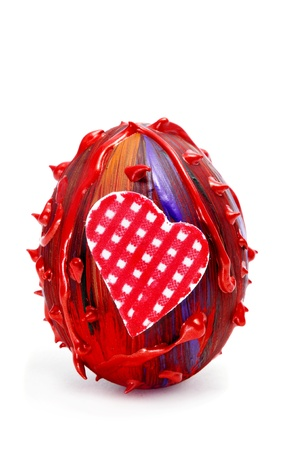 an easter egg of different colors with a heart, on a white background photo