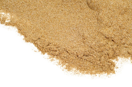 sand grains: closeup of a pile of sand on a white background Stock Photo