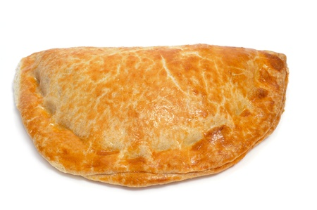 closeup of an empanada, a cake stuffed with vegetables and meat photo