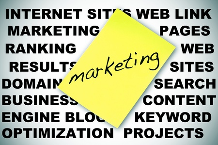 word MARKETING written in a sticky note and concepts about social engine optimization and internet subjects Stock Photo - 18126741