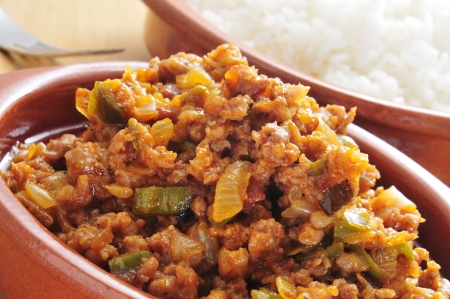 rico: closeup of a earthenware plate with picadillo, a traditional dish in many latin american countries, served with rice