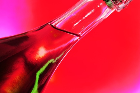 closeup of a bottle of rose sparkling wine on a red background Stock Photo - 18126743