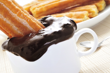 churros: a pile porras, thick churros typical of Spain, dipped in hot chocolate