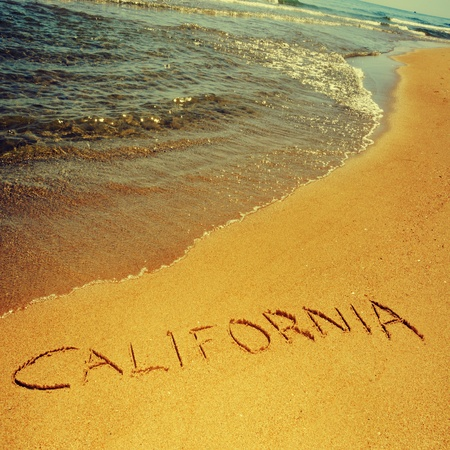 sand writing: california written on the sand of a beach, with a retro effect