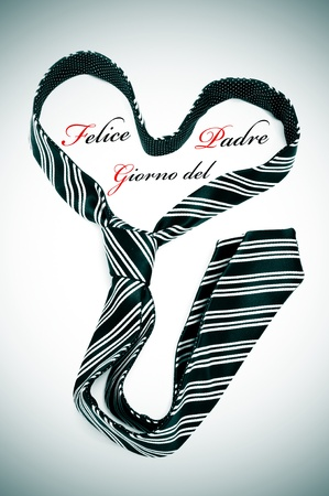 felice: a tie forming a heart and the sentence felice giorno del padre, happy fathers day written in italian