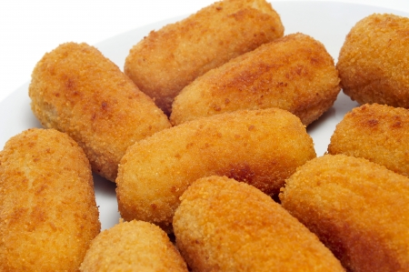 croquettes: closeup of plate with spanish croquettes served as tapas
