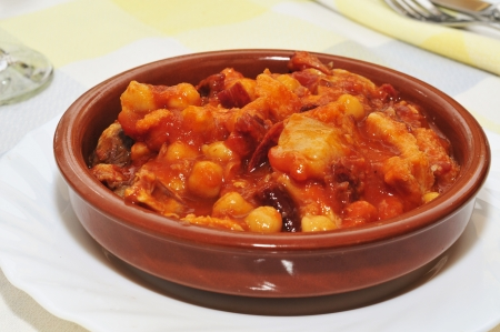 spanish callos, a stew with beef tripe, chickpeas and chorizo typical of Spain photo