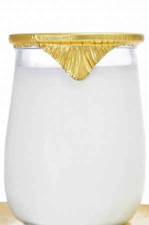 yogurt natural: primer plano de un yogur en un tarro de cristal Foto de archivo