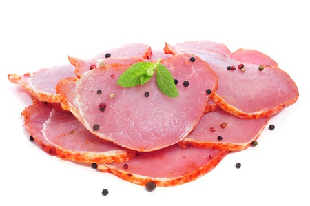 butchering: some slices of raw marinated tenderloin with peppercorns on a white background Stock Photo
