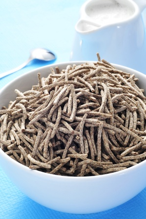 closeup of a bowl cereal bran sticks on a table at breakfast time photo