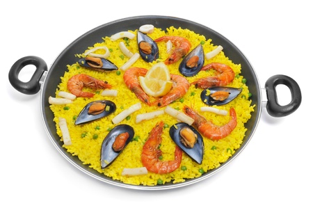 a typical paella from Spain, with mussels and prawns, on a white background photo