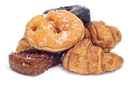 a pile of pastries, such as croissants, donuts and chocolate pie, on a white background photo