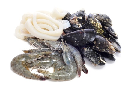 mollusc: a pile of different raw seafood, such as shrimps, mussels and squid rings