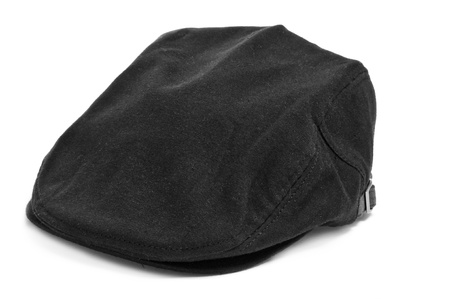 headgear: a black flat cap on a white background