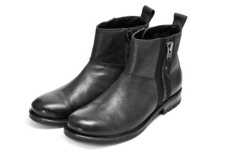 bootstrap: a pair of black leather boots for man with bootstraps on a white background Stock Photo
