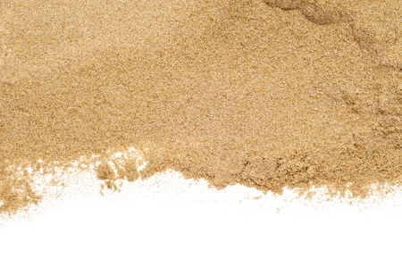 sand grains: closeup of a pile of sand of a beach or a desert on a white background