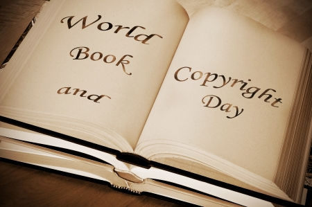 sentence world book and copyright day, celebrated each year on april 23, written on an open book photo