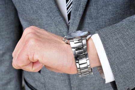 a man wearing a suit looking at his watch Stock Photo - 18513346