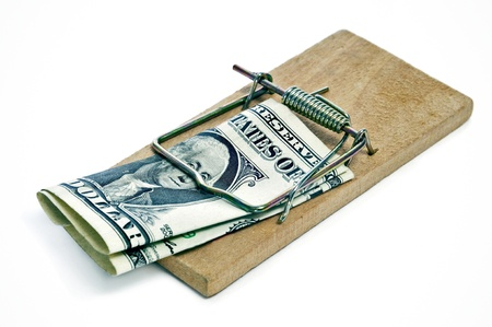 one dollar bill in a mousetrap on a white background photo