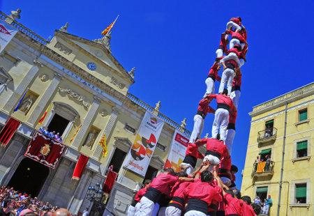 folk heritage: Tarragona, Spain - September 16, 2012: Castells in Tarragona, Spain. Every year, during Santa Tecla festival, those typical catalan human towers are performed in Plaza de la Font Editorial