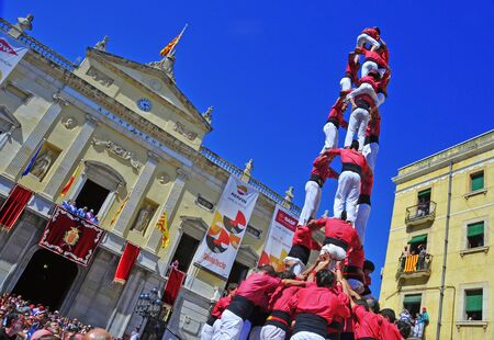 Tarragona, Spain - September 16, 2012: Castells in Tarragona, Spain. Every year, during Santa Tecla festival, those typical catalan human towers are performed in Plaza de la Font Editorial
