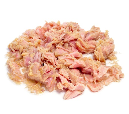 canned meat: a pile of tuna meat from a can on a white background