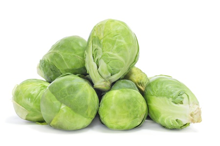 a pile of Brussels sprouts on a white background photo