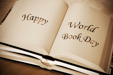 sentence happy world book day, celebrated each year on april 23, written on an open book