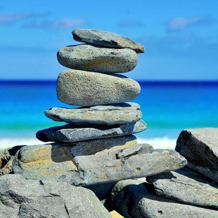 sea mark: closeup of a stack of stones on a beach