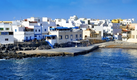 La Oliva, Spain - June 26, 2012: View of El Cotillo in La Oliva, Fuerteventura, Canary Islands, Spain. This charming small fishing village is famous for its excellent fish restaurants Stock Photo - 18699594
