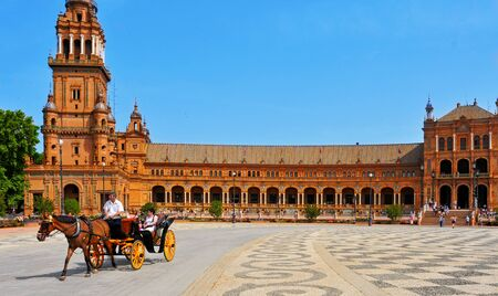 maria: Seville, Spain - May 17, 2012: View of Plaza de Espana in Seville, Spain. Plaza de Espana complex, built in 1929, is a huge half-circle with a total area of 50,000 square meters