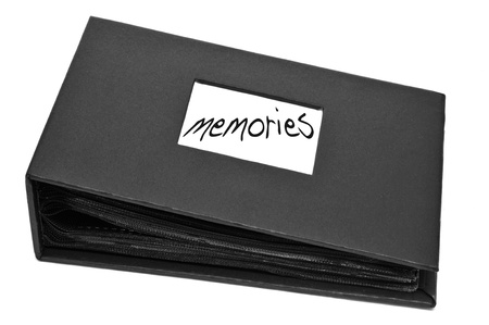 a photo album with the word memories written on it on a white background photo