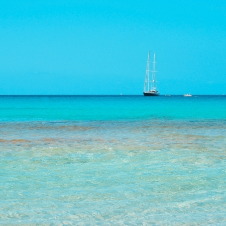 seawater: boat in a blue and clear seawater in Formentera, Balearic Islands, Spain