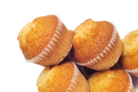 madeleine: a pile of plain cupcakes on a white background Stock Photo