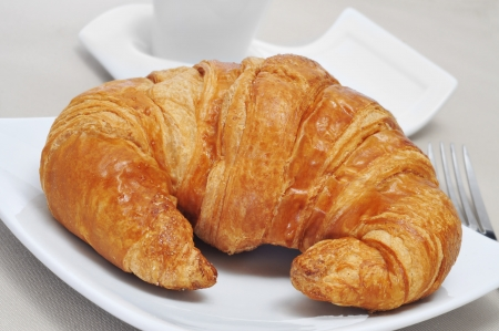 continental breakfast  cup of coffee and croissant photo