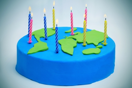a cake decorated as a world map with candles for the International Mother Earth Day Stock Photo - 18784819