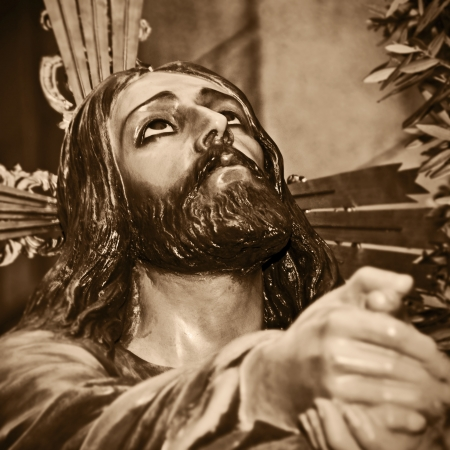 a representation of Jesus Christ praying in the Garden of Gethsemane photo