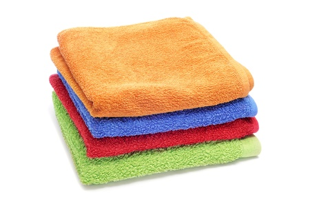 terrycloth: a pile of towels of different colors on a white background Stock Photo