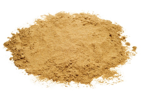 white sand beach: closeup of a pile of sand on a white background Stock Photo