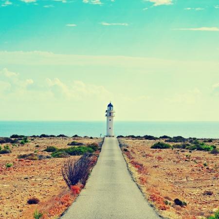 instagram: View of beacon Far de Barbaria in Formentera, Balearic Islands, Spain, with a retro effect