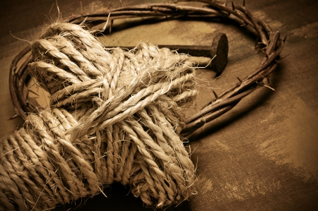 closeup of a representation of the Jesus Christ crown of thorns and nail, and a rope cross photo