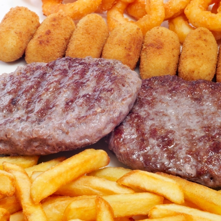 closeup of a spanish combo platter with burgers, croquettes, calamares and french fries Stock Photo - 19004159
