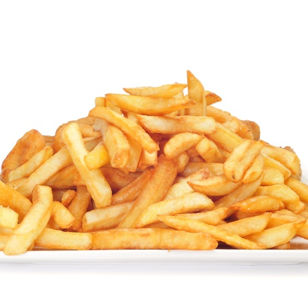 quick snack: a pile of appetizing french fries on a white background Stock Photo