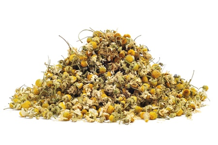 herbalist: a pile of dried chamomile flowers on a white background
