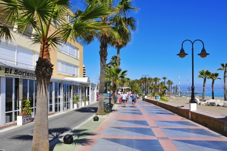 promenade: Torremolinos, Spain - March 13, 2012: Ocean front walk and Bajondillo Beach  in Torremolinos, Spain. This popular beach is about 1,100 meters long and 40 meters average width Editorial