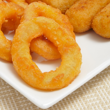 closeup of a plate with spanish croquettes and calamares a la romana, squid rings Stock Photo - 19266484