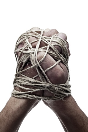 symbol victim: man hands tied with string, as a symbol of oppression or repression, on a white background