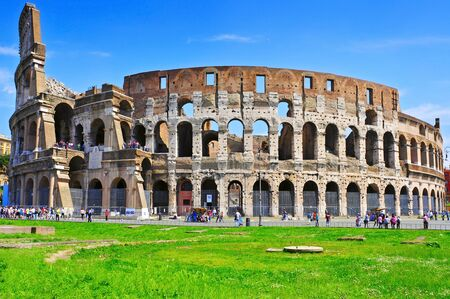 Venice, Italy - April 17, 2013: The Flavian Amphitheatre or Coliseum in Rome, Italy. The Coliseum is an iconic symbol of Rome and one of the most popular tourist attractions in the city