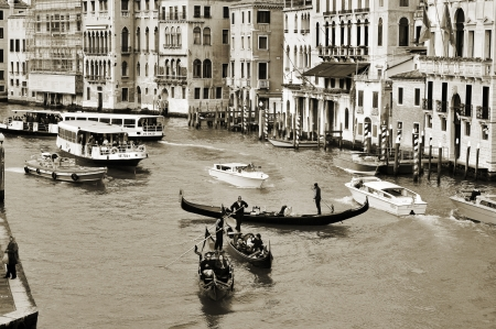 moorings: Venice, Italy - April 11, 2013: A view of the Grand Canal from Rialto Bridge in Venice, Italy. This main canal is 3800 meter long, 30?90 meters wide, with an average depth of five meters